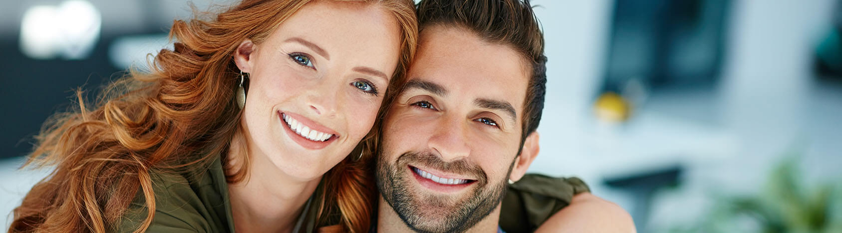 Woman with arm around man smiling